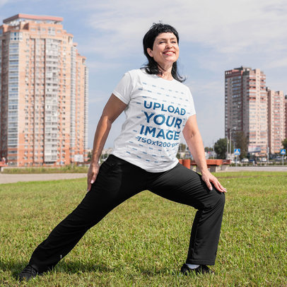 T-Shirt Mockup of a Happy Woman Stretching at a Park m1767-r-el2