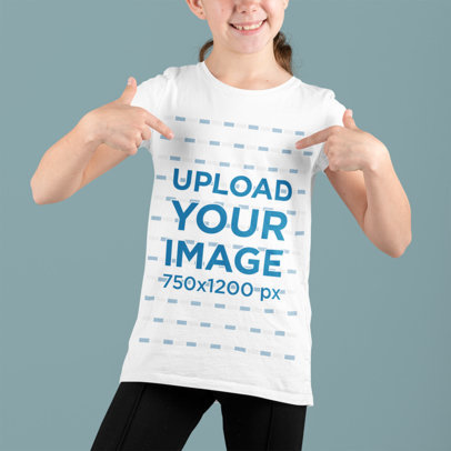 Mockup of a Happy Girl Ponting at Her T-Shirt in a Studio m691