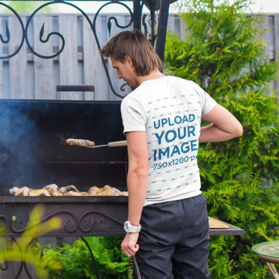 Back View T-Shirt Mockup of a Man Grilling m2681-r-el2