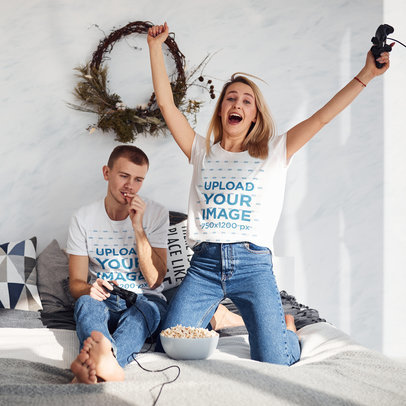 T-Shirt Mockup of a Happy Woman Playing Video Games with Her Boyfriend m2306-r-el2