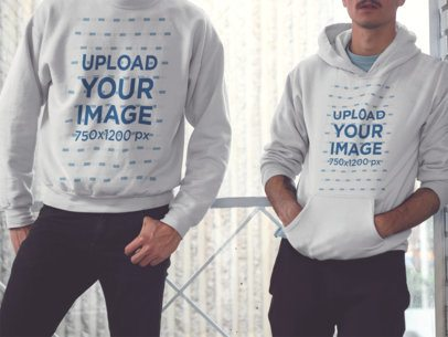 Mockup of Two Friends with Cropped Face Wearing a Crewneck Sweatshirt and a Pullover Hoodie with Different Designs a15635