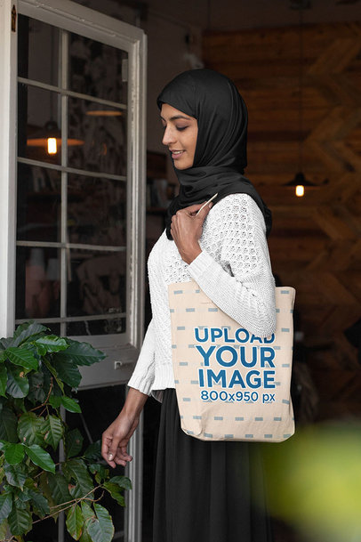 Tote Bag Mockup Featuring an Elegant Woman in a Hijab 32385a