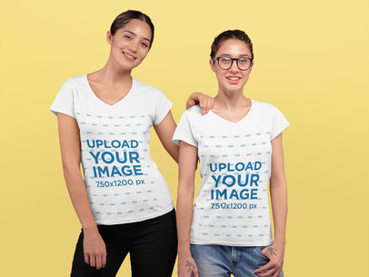 V-Neck T-Shirt Mockup Featuring Two Young Women at a Studio 25945a
