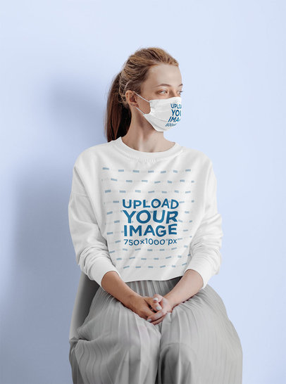 Sweatshirt and Face Mask Mockup Featuring a Woman Sitting in a Studio m2443-r-el2