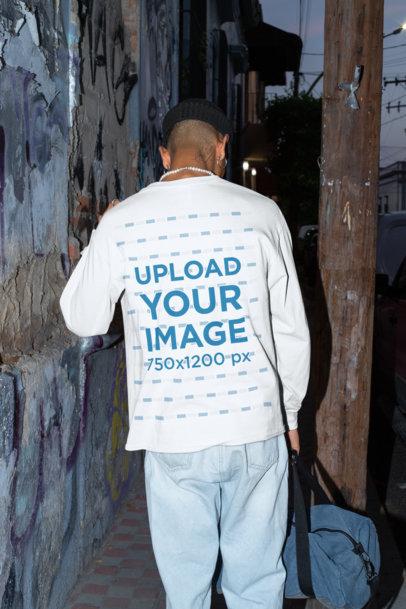 Back-View Long Sleeve Tee Mockup of a Man Walking by a Dark Street m581