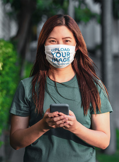 Face Mask Mockup of a Woman with Her Phone on the Street m1819-r-el2