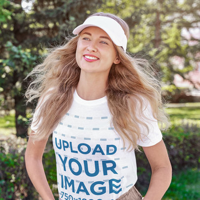 T-Shirt Mockup of a Happy Young Woman Strolling at a Park m1610-r-el2