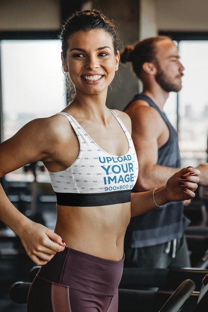 Sports Bra Mockup Featuring a Woman Jogging on a Treadmill m2839-r-el2