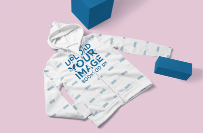Mockup of a Sublimated Hoodie Laid Flat by Some Blocks 5115-el1