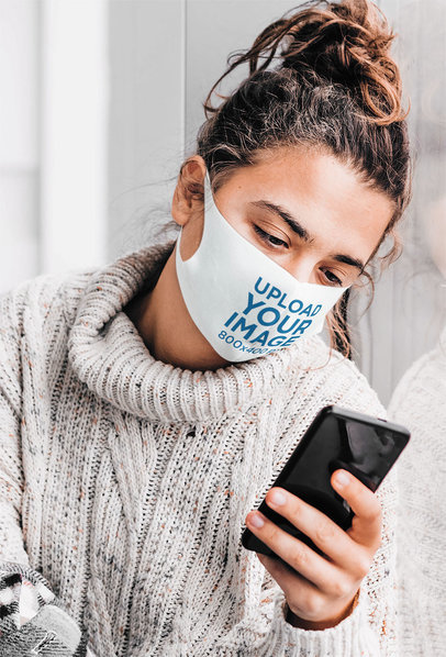 Face Mask Mockup of a Woman Checking on Her Phone by the Window m2016-r-el2