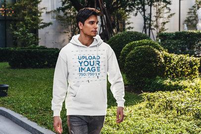 Hoodie Mockup of a Young Man Walking Through a Park 5116-el1