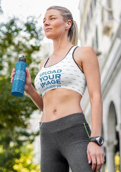 Sports Bra Mockup of a Fit Woman Holding a Bottle m2601-r-el2
