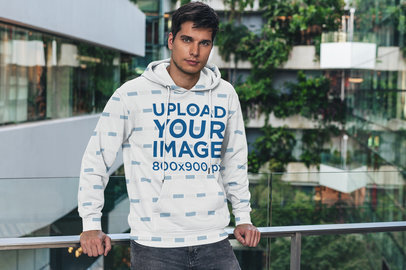 Sublimated Hoodie Mockup Featuring a Man Posing by a Handrail 5119-el1