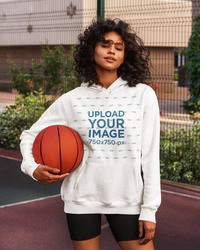 Hoodie Mockup of a Long-Haired Woman Holding a Basketball 5130-el1