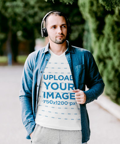V-Neck Tee Mockup of a Man Taking a Stroll While Listening to Some Music m2837-r-el2
