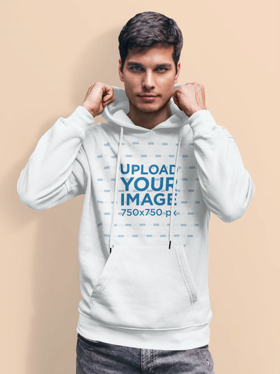 Pullover Hoodie Mockup Featuring a Man Posing Against a Solid Surface 5124-el1