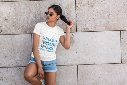 T-Shirt Mockup of a Woman Wearing Sunglasses and Holding Her Ponytail 5180-el1