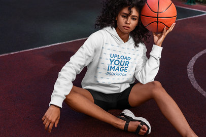 Hoodie Mockup of a Serious Curly-Haired Woman Posing With a Basketball 5135-el1