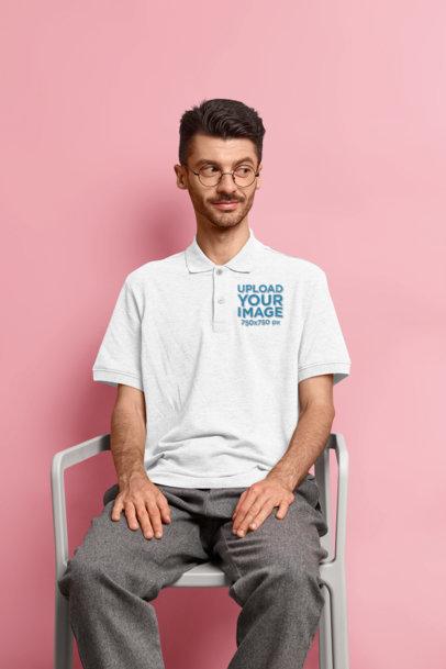 Polo Shirt Mockup of a Man Sitting in a Studio M3225-r-el2