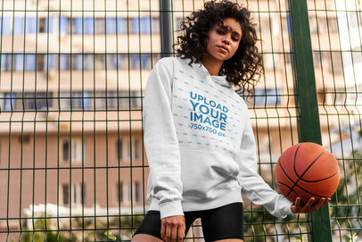 Hoodie Mockup of a Curly-Haired Woman Holding a Basketball 5137-el1
