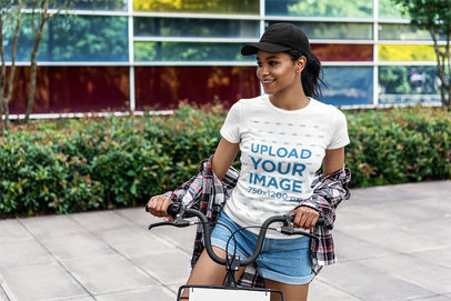T-Shirt Mockup of a Happy Young Woman Riding Bicycle 5185-el1