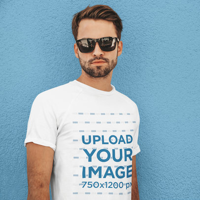 Basic T-Shirt Mockup of a Serious Man With Sunglasses Against a Colored Wall m1533-r-el2