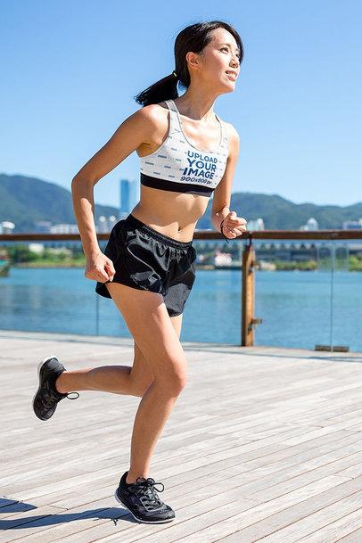 Sports Bra Mockup Featuring a Happy Woman Running by a Lake m2836-r-el2