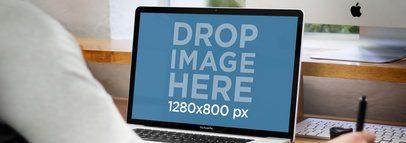 MacBook Pro Designer Working Wide