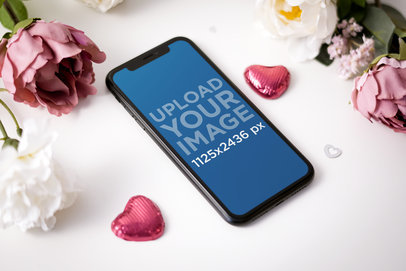 Mockup of an iPhone 11 Surrounded by Saint Valentine's Ornaments 5147-el1