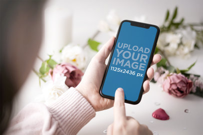 iPhone 11 Mockup Featuring Roses in the Background 5144-el1