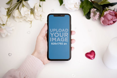 Mockup of a Woman Holding an iPhone 11 by Valentine's Day Roses 5143-el1