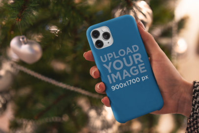 Phone Case Mockup Featuring a Christmas Tree in the Background 5174-el1