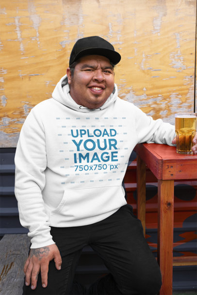 Hoodie Mockup Featuring a Happy Man Having a Beer 32858a