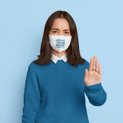 Face Mask Mockup of a Woman Doing a Stop Sign in a Studio m3348-r-el2