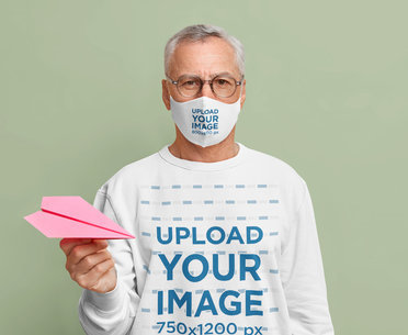 Face Mask and Sweatshirt Mockup of a Man Holding a Paper Plane m3365-r-el2
