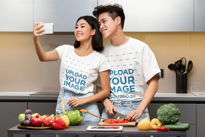 T-Shirt Mockup of a Couple Taking a Selfie While Cooking m3425-r-el2