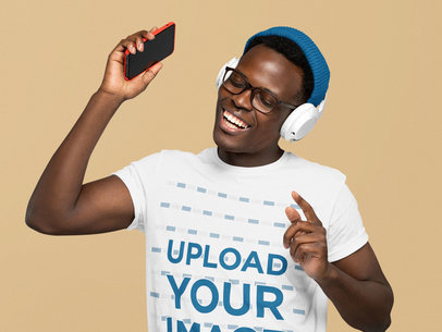 Basic T-Shirt Mockup of a Happy Man Listening to Fun Music at a Studio m2216-r-el2