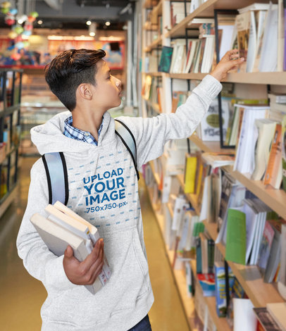 Hoodie Mockup of a Teenage Boy at a Bookstore 46945-r-el2
