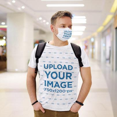 Mockup of a Man Wearing a T-Shirt and a Face Mask at a Shopping Mall 45628-r-el2
