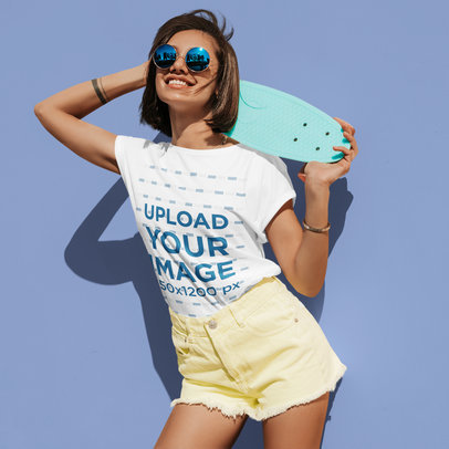 T-Shirt Mockup of a Young Woman with an Arm Tattoo Holding a Penny Board M1723-r-el2