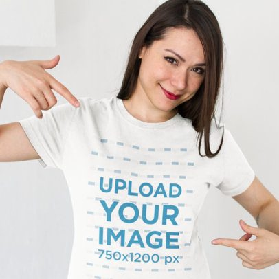 Smiling Customer Showing her New T-Shirt Mockup Against a White Background a15529