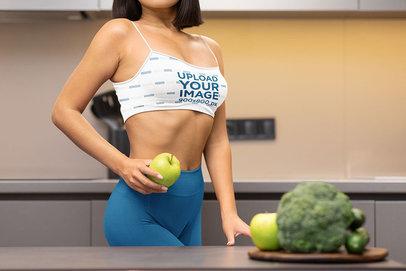 Sports Bra Mockup Featuring a Woman Holding an Apple m3537-r-el2