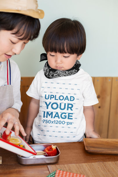 T-Shirt Mockup of a Little Boy Helping His Mom with Lunch 39716-r-el2