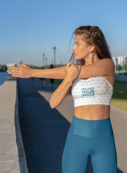 Sports Bra Mockup of a Long-Haired Woman Stretching m3679-r-el2