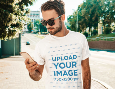 T-Shirt Mockup of a Bearded Staring at His Phone While in the Street M1528-r-el2