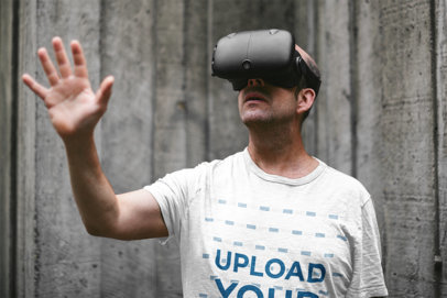 T-Shirt Mockup of a Middle-Aged Man Using a VR Device 41053-r-el2