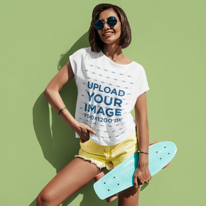 Mockup of a Short-Haired Woman Wearing a Slouchy Tee While Holding a Penny Board m1726-r-el2