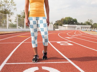 Track and Field Uniforms - Mockup of a Girl Wearing Leggings While Walking at the Running Track a15325