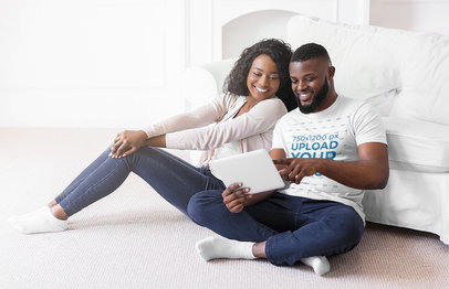 T-Shirt Mockup of a Couple Checking a Tablet in their Living Room 41054r-el2
