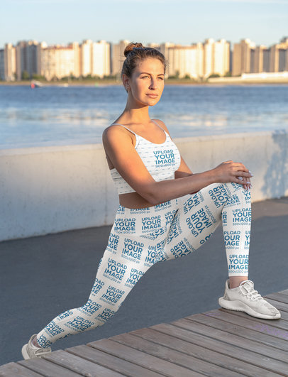 Sports Bra and Leggings Mockup Featuring a Woman and a Beach in the Background m3690-r-el2